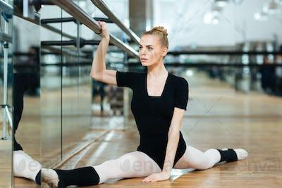 Ballerina doing stretching exercise