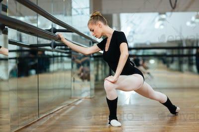 Ballerina doing stretching exercises