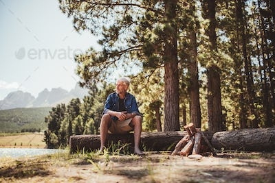 Mature man relaxing by a lake