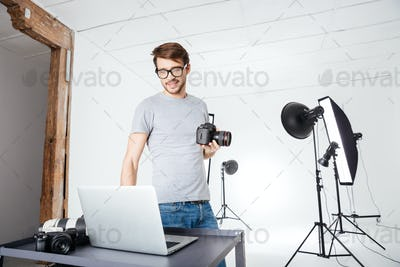 Photographer using laptop computer