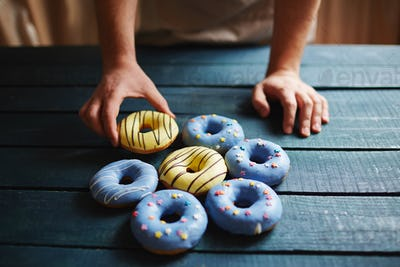 Putting donuts on table