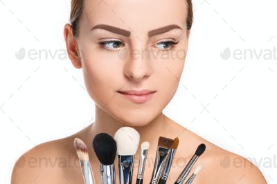 Beautiful female eyes with make-up and brushes