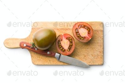 halved dark tomatoes