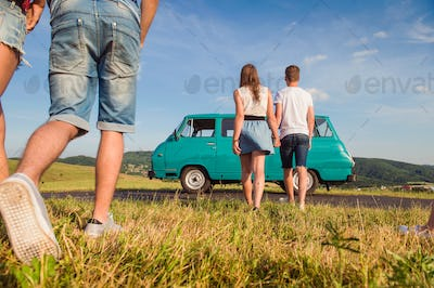 Couples in love, nature, blue sky, campervan, back view
