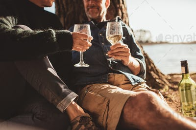 Couple drinking wine on camping