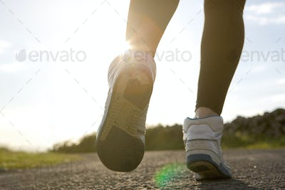 Low angle of woman jogging on street