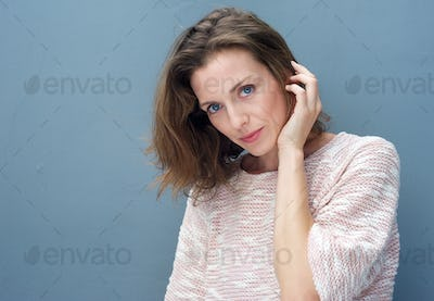 Attractive woman posing with hand in hair