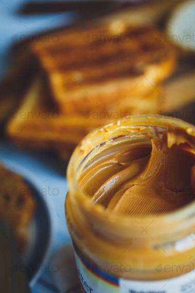 Open jar of peanut butter