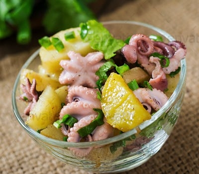Potato salad with pickled octopus and green onions.