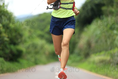 young fitness woman trail runner running on trail