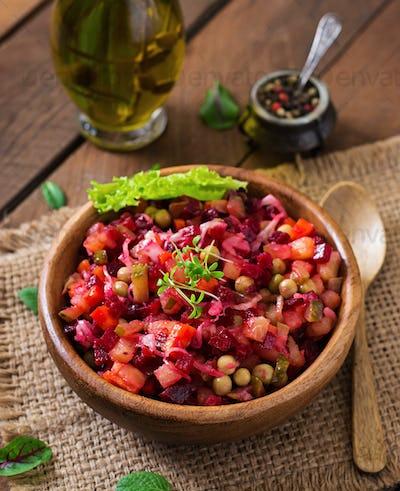 Beet salad Vinaigrette in a wooden bowl