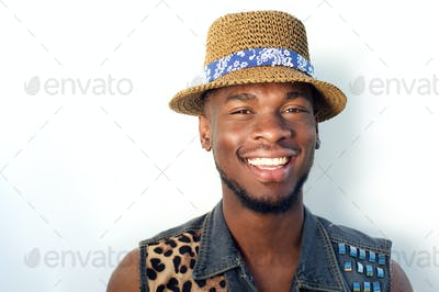 Happy black man smiling with hat on white background