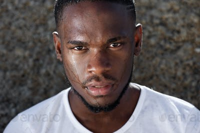 Young african american man with sweat dripping down face