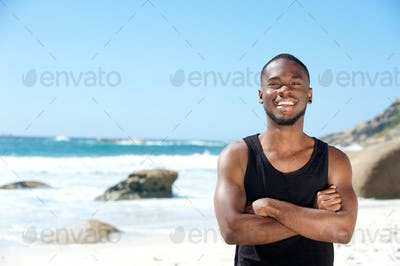 Cool guy smiling at the beach