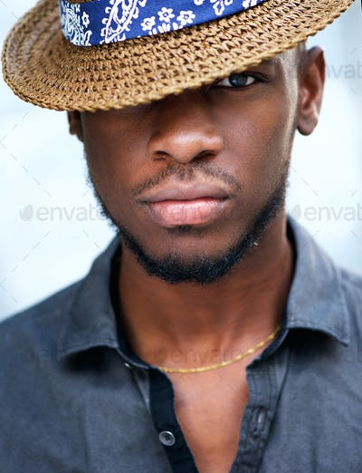 Stylish young african american man with hat