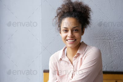 Happy mixed race woman smiling indoors