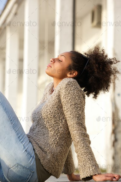 Young woman relaxing outside