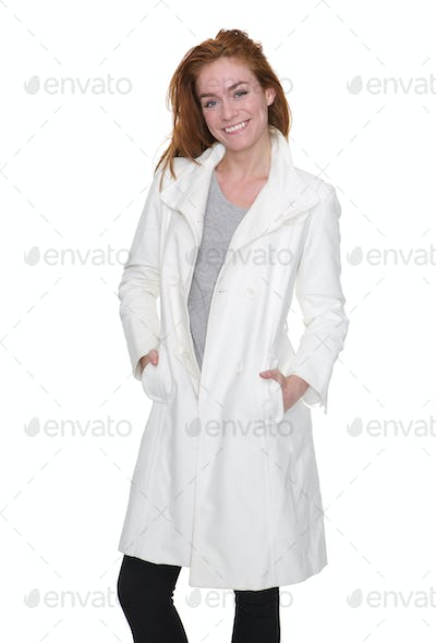 Young woman smiling in elegant white winter jacket