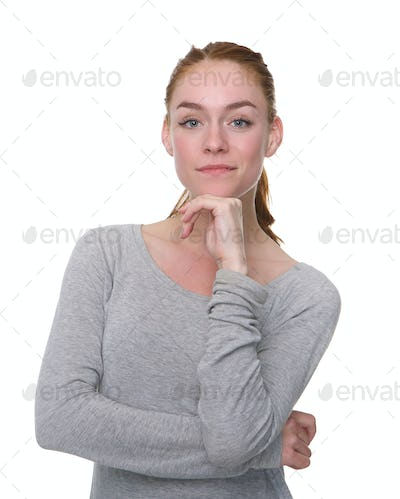 Serious young woman with hand on chin