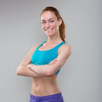 Confident sporty woman smiling with arms crossed