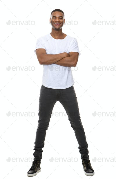 Full length portrait of a cool young guy smiling with arms crossed