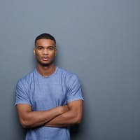 Handsome african american man posing with arms crossed