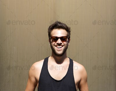 Handsome young man smiling with sunglasses
