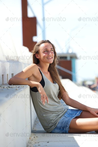 Young woman sitting outside on steps