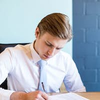 Young businessman in business meeting in conference room at office