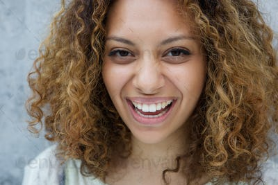 Young woman with curly hair laughing