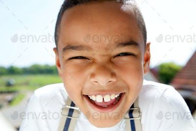 Portrait of a smiling little boy with suspenders
