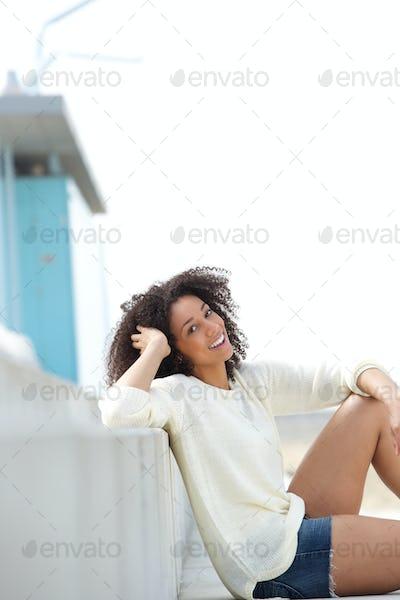 Cute young woman relaxing outdoors