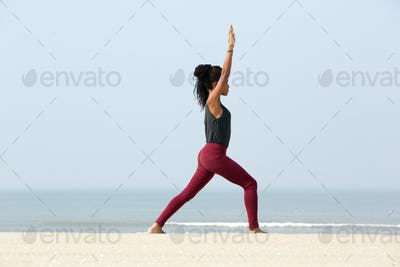 Woman stretching with arms raised