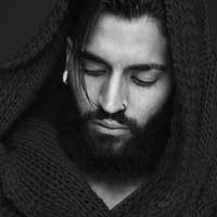 Black and white portrait of a man with beard and scarf