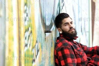 Man with beard and piercings