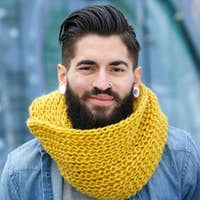 Smiling man with wool scarf