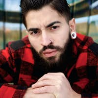 Young guy with beard and piercings