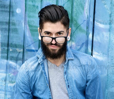 Young man with beard and glasses
