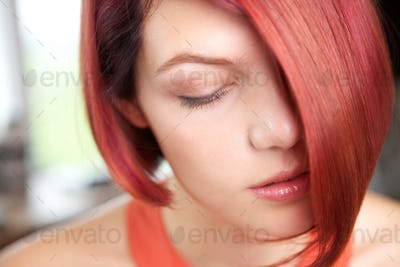 Calm young woman with eyes closed