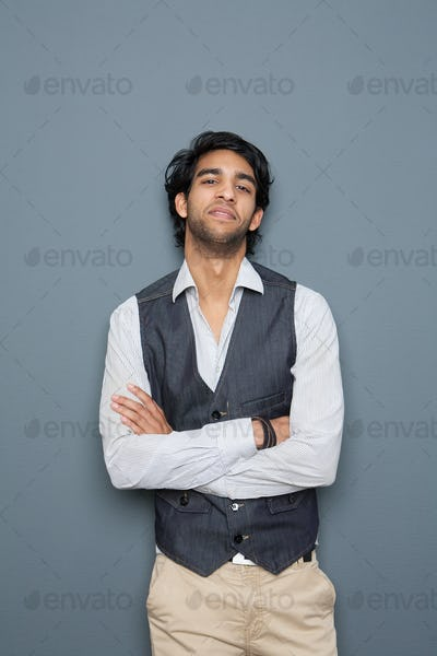 Casual young businessman posing with arms crossed