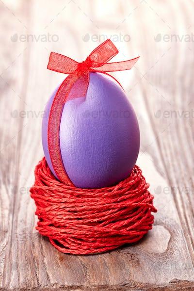 Easter painted egg in nest, handmade on wood