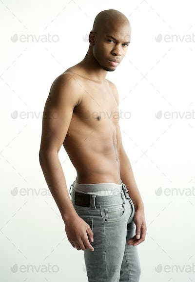 Handsome male fashion model with no shirt