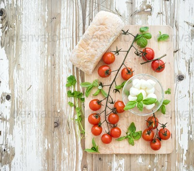 Ciabatta bread with banch of cherry-tomatoes, basil and mozzarella cheese