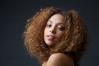 Beauty portrait of a pretty young woman with curly hair