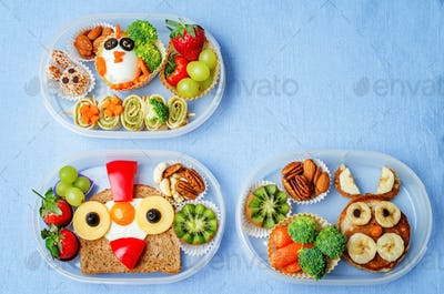 school lunch box for kids with food in the form of funny faces
