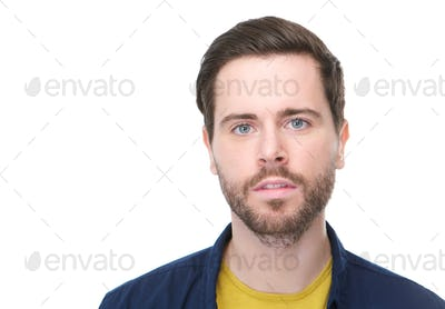 Handsome young man with beard looking at camera