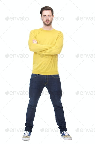 Portrait of a cool guy standing with arms crossed