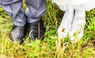 feet and shoes of newlyweds