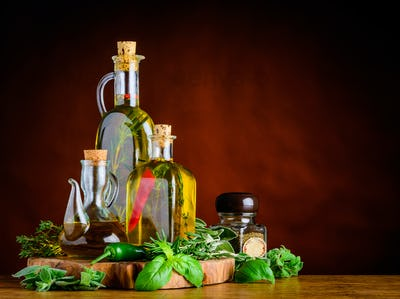Virgin Olive Oil, Basil and Rosemary with Copy Space
