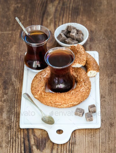 Turkish traditional black tea in a glass and turkish bagel simit